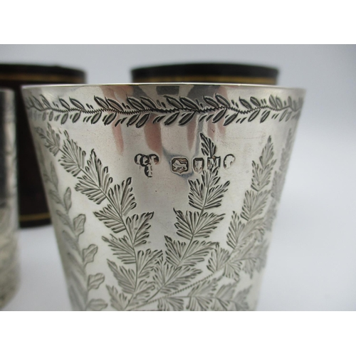 1 - Two late Victorian silver beakers by Edwin Charles Purdie, London 1883 and 1887, both etched with fo...