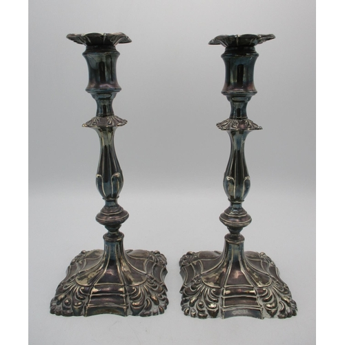 16 - A pair of Victorian silver candlesticks by Henry Wilkinson, Sheffield 1894, designed with knapped st...