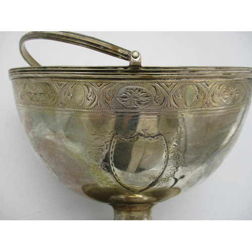 17 - A George III silver swing handled sugar basket by Henry Chawner, London 1791, boat shaped with brigh...