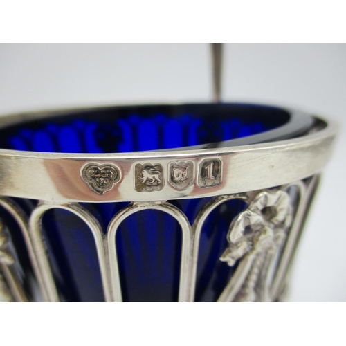 18 - An Edward VII silver swing handle sugar bowl by Goldsmiths and Silversmith co., with pierced body an...