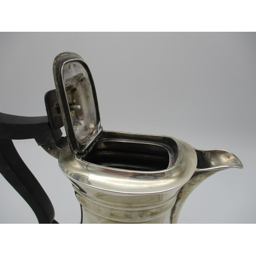 19 - A George V silver coffee pot by William Hutton & Sons, Sheffield 1911, with ebonised handle and fini...