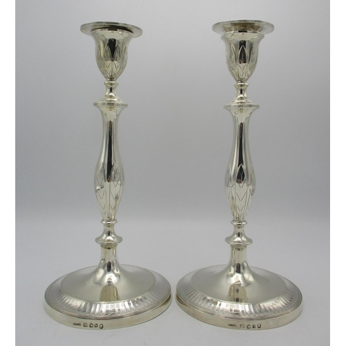 4 - A pair of William IV silver candlesticks by John Green & Co, Sheffield 1834, in the Georgian taste w...
