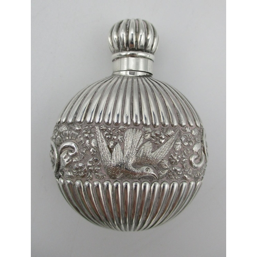 7 - A Victorian silver snuff bottle by Samson Mordan, London 1888, of circular form with fluted design b...