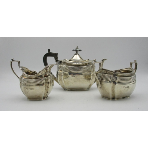 8 - A late Victorian silver three piece tea set by John Round & Son, Sheffield 1895, retailed by Edwards...