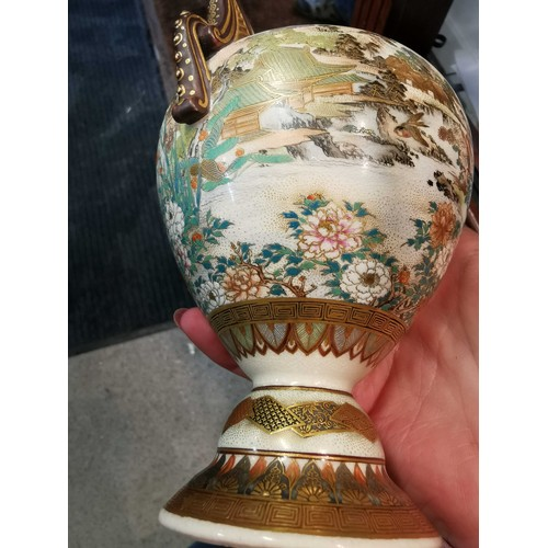 8 - A Japanese Meiji period Satsuma vase and cover of ovoid form, with twin handles and a splayed foot, ...