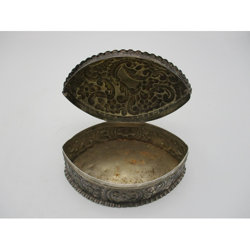 23 - A Victorian silver table box by Horton & Allday, Birmingham 1888, almond shaped with repousse flower...