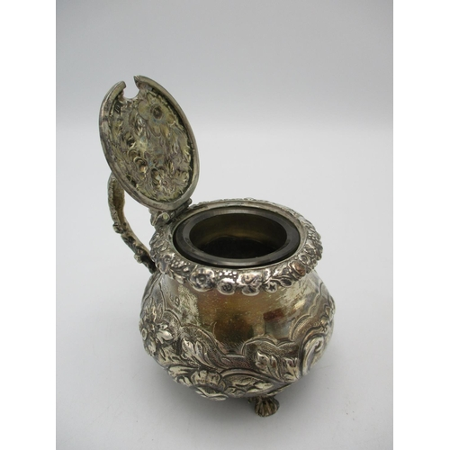 24 - A George IV silver mustard pot by Joseph Biggs, London 1825, of bulbous form with embossed foliage a...