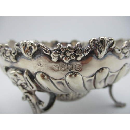 30 - A Victorian silver footed sweetmeat dish by William Comyns & Sons, London 1886, with floral swags an...