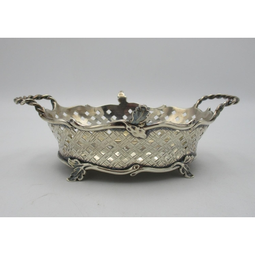 31 - A Victorian silver basket by Joseph Rodgers & Sons, Sheffield 1898, modelled with pierced woven wick...