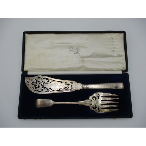 33 - A cased near pair of Victorian fish servers, by Mappin Brothers and Henry John Lias & James Wakely, ...