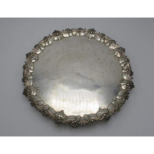 34 - A Victorian silver salver by the Goldsmiths Alliance Ltd, London 1867, of circular shape with shell ...