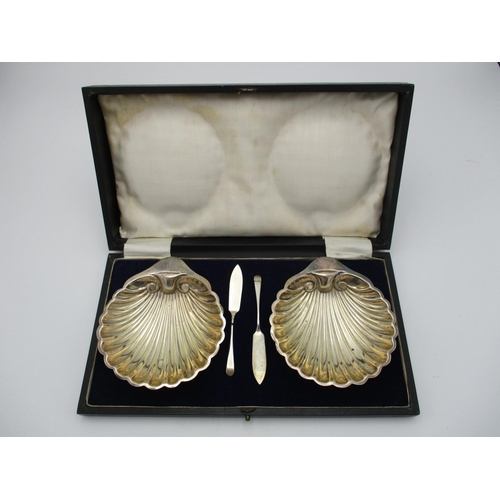 36 - A cased pair of George V silver butter dishes by Harrison Brothers and Howson, Sheffield 1921, model...