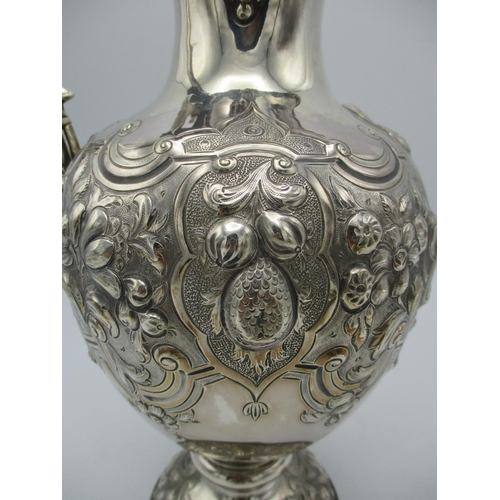 38 - A Victorian silver wine jug by Martin Hall, Sheffield 1860, with scroll handle ending in a lion mask...