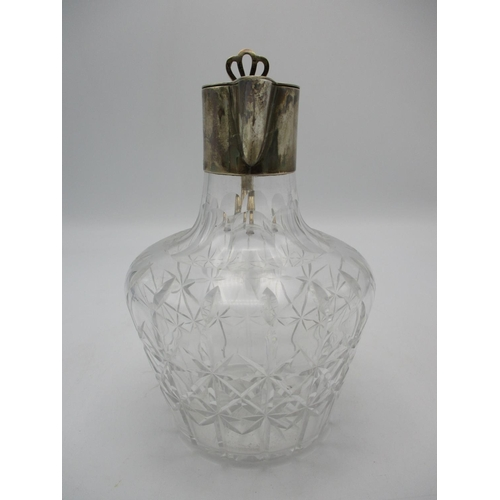 42 - A Victorian silver mounted claret jug, with star cut glass baluster shaped body, the silver mounts b...