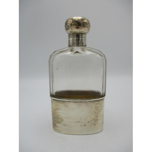 43 - A George V silver mounted glass hip flask, with engine turned detail to the lid, glass body with fac...