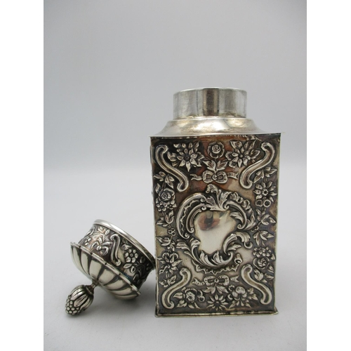 46 - A Victorian silver tea caddy by William Comyns & Sons, London 1897, of rectangular form with embosse...