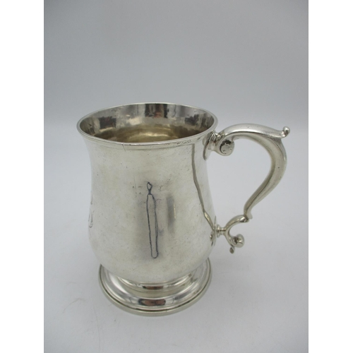 47 - A George II silver tankard by Robert Collier, London 1748, with bell shaped body, scrolled handle an...