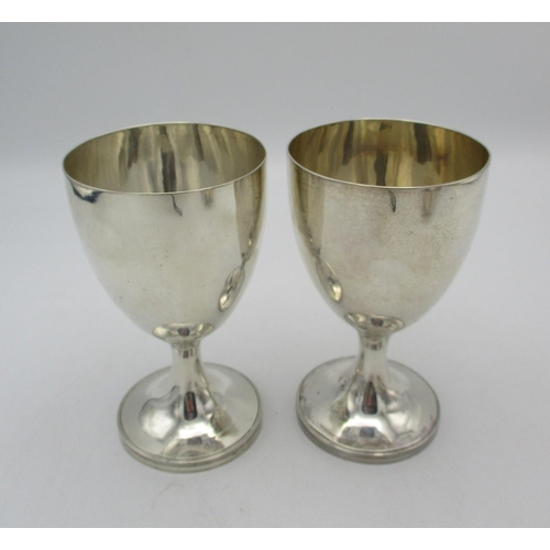 48 - A pair of George III silver goblets by Henry Chawner, London 1789, with plain bodies on short waiste...