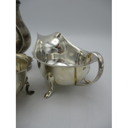 39 - An Edwardian silver sugar caster by Harrison Brothers and Howson, London 1909, together with a mid c...