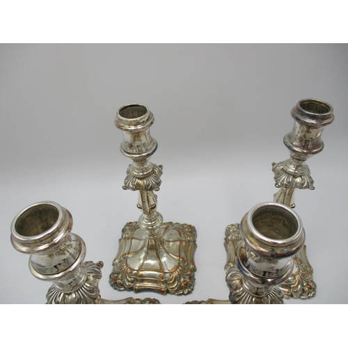 49 - A set of four Georgian style silver plated candlesticks, with detachable sconces, the capitals and b...