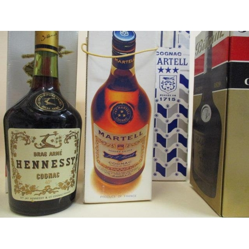 31 - Seven bottles of mixed spirits to include Martell Cognac and Hennessy Cognac Location: STACK...