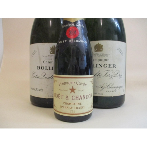 34 - Two Magnum bottles of Bollinger Extra Quality very dry Champagne, 150cl and one half bottle of Moet ...