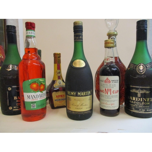 35 - A selection of mixed bottled spirits to include Remy Martin cognac, 24 fl oz Location: R.3...