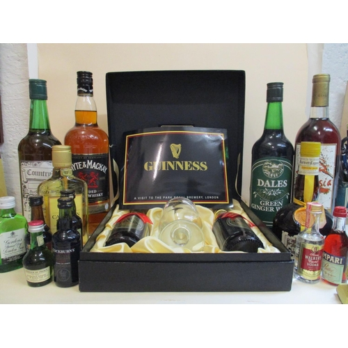 36 - A Guinness presentation case with Toucan Inn Visitor glass and two bottles of Guinness and mixed spi...