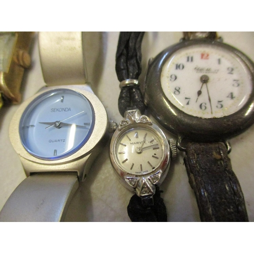 13 - A group of wristwatches to include Rotary, Seiko, Swarovski and a yellow metal part cased ladies coc...