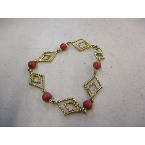 15 - A 9ct gold and five coral coloured bead bracelet, total weight 7.4g, together with early to late 20t...