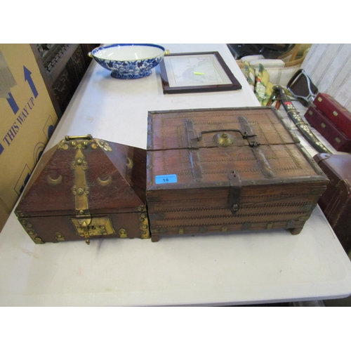 18 - Two wooden middle Eastern/North African boxes, one with applied brass work, lock and carrying handle...