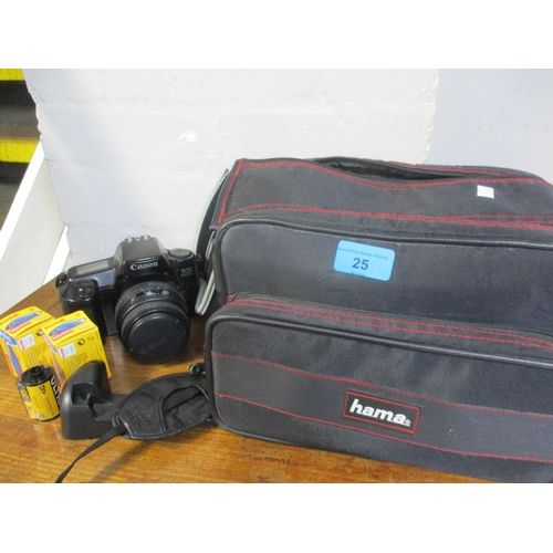 25 - A Canon EOS, 1000F, camera with a Sigma lens, a travel bag and accessories Location: RWB...