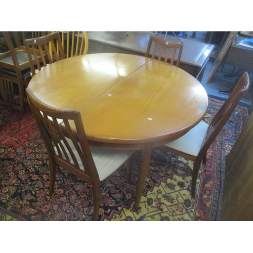 28 - A mid 20th century G-Plan teak extending dining table 73cm h x 122cm w, and four dining chairs Locat...