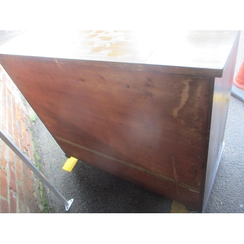 32 - A Victorian mahogany chest of four long drawers having barley twist supports and bun shaped handles ...