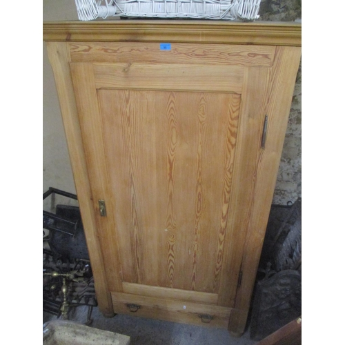 35 - A reproduction pitch pine single door armoire with single drawer below, 175cm h x 102cm w Location: ...