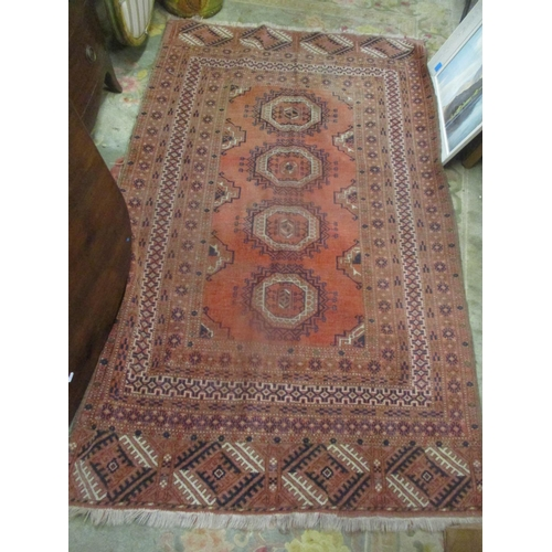 38 - A Bokhara red ground rug having multi-guard borders and tasselled ends, 203cm x 121cm Location: G...