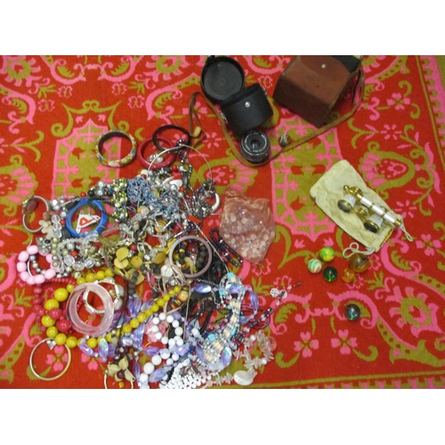 46 - A Retro Casa Pupa style pink ground rug together with costume jewellery, an Oris watch, mother of pe...
