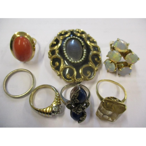 6 - Yellow metal rings to include a silver gilt and five opal style ring, 5.1g together with a yellow me...