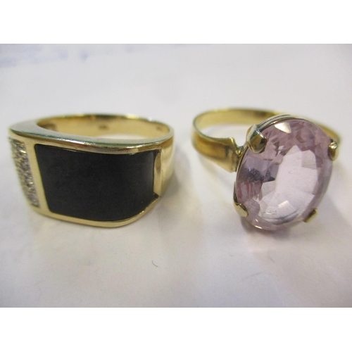 7 - A gents 14ct, black stone and diamond chip ring, 5.1g together with a yellow metal and pink sapphire...