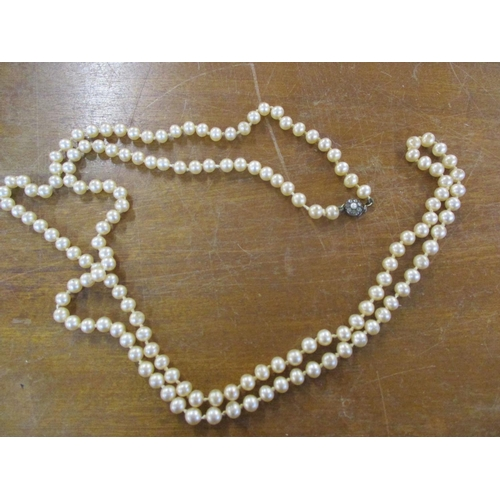 48 - A pearl necklace with a clasp stamped 960, a pair of Mexican white metal earrings inlaid with mother...