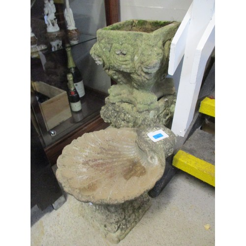 23 - A stone birdbath in the form of a clam shell together with two pedestal stone platers of square form...