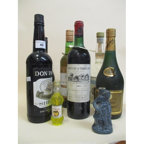 49 - Eight bottles of mixed spirits and wine to include Chateau D Angludet Margaux 1980 and Cognac Locati...