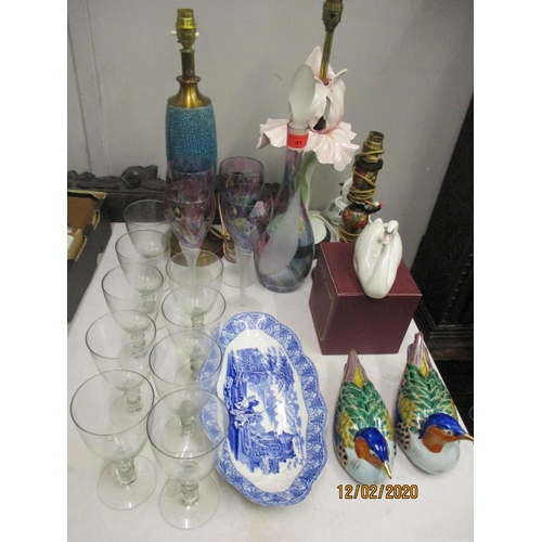 21 - Ceramics and glassware to include three lamps, a set of coloured glasses and matching decanter, Shel...