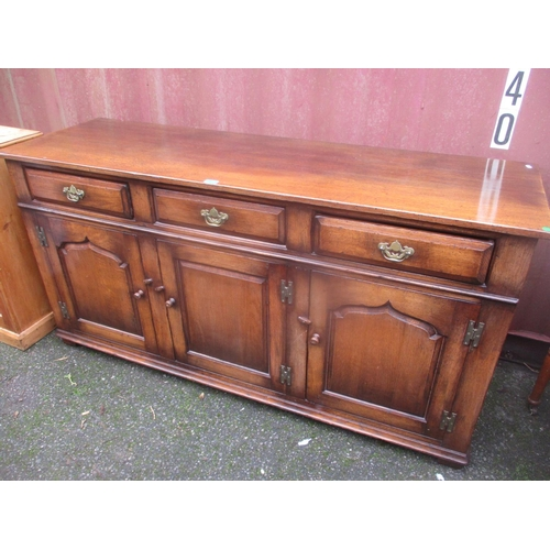 2 - A reproduction oak Titchmarsh & Goodwin sideboard with three drawers and three cupboard doors below ...