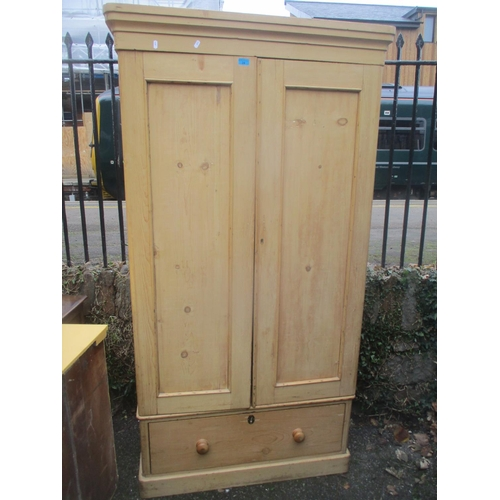 24 - A Victorian pine two door wardrobe with single drawer below and on a plinth base 199cm h x 96cm w Lo...