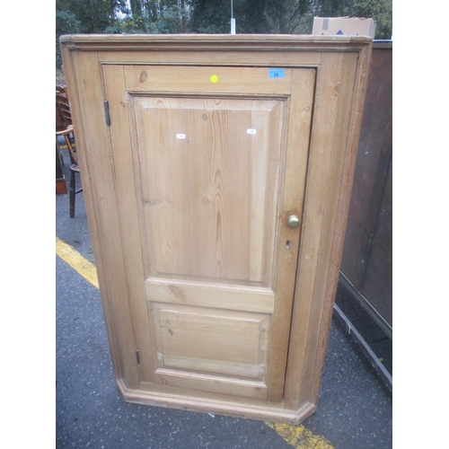 28 - A 19th century large pine corner cabinet with single door and fitted shelves 138cm h x 87cm w Locati...