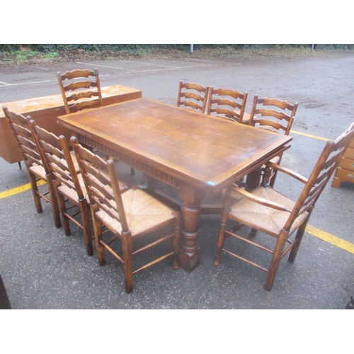 3 - A reproduction oak Titchmarsh & Goodwin extending dining table, together with a set of eight oak lad...