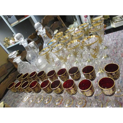 31 - Five glass decanters with five stoppers to include two claret jug decanters, a set of eighteen Muran...