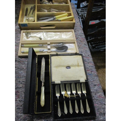 32 - Boxed Laguiole salad servers, mixed silver plate and stainless steel cutlery and flatware, an Arthur...