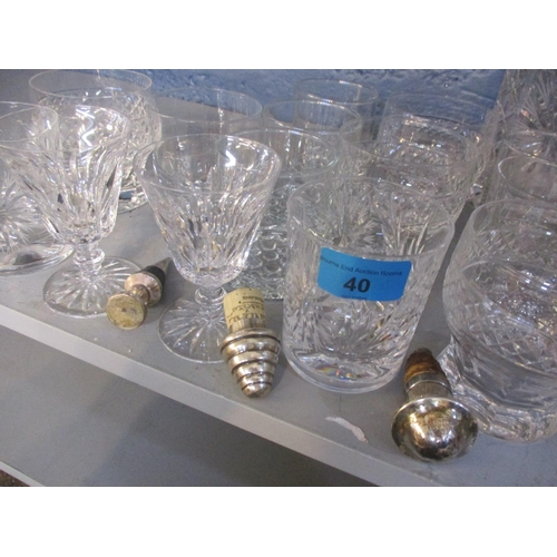 40 - A pair of Waterford crystal sherry glasses, pattern unknown, together with two decanters, mixed glas...